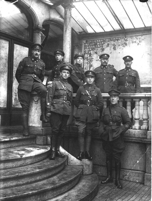 Posed indoor group of NCOs wearing Oliver gear and 5 button tunics